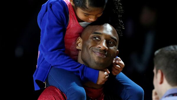 Los Angeles Lakers Kobe Bryant holds his daughter Natalia during practice for the NBA All-Star basketball game in Houston, Texas, February 16, 2013. - Sputnik International