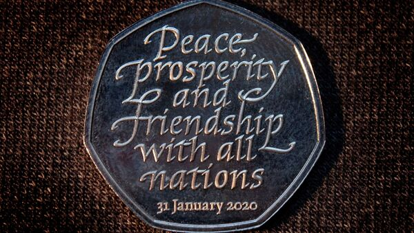 Brexit commemorative 50 pence coin that bears the words Peace, prosperity and friendship with all nations is pictured in an unknown location and uploaded to social media on January 26, 2020 - Sputnik International