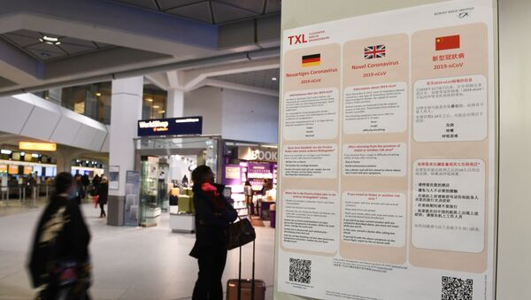 A poster with information about the coronavirus (2019-nCoV) is displayed at Tegel Airport in Berlin, Germany, January 26, 2020.   - Sputnik International