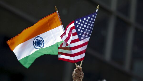 A man holds the flags of India and the U.S. while people take part in the 35th India Day Parade in New York August 16, 2015. - Sputnik International