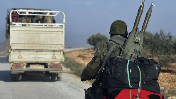 Soldiers of Syrian army are seen after the liberation of Jaranjaz town from militants, northwestern province of Idlib, Syria. Due to the location of Jarjanaz, this will enable the army to take control over the important Hama-Aleppo road in Idlib, which remains a terrorist stronghold. - Sputnik International