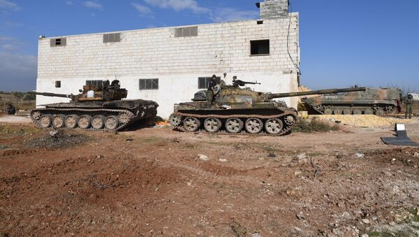 Tanks of Syrian army are seen during the liberation of the Jarjanaz town from the militants, northwestern province of Idlib, Syria. Due to the location of Jarjanaz, this will enable the army to take control over the important Hama-Aleppo road in Idlib, which remains a terrorist stronghold. - Sputnik International