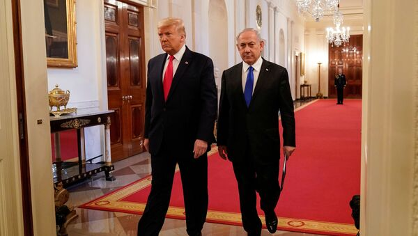 U.S. President Donald Trump and Israel's Prime Minister Benjamin Netanyahu arrive to deliver joint remarks on a Middle East peace plan proposal in the East Room of the White House in Washington, U.S., January 28, 2020. - Sputnik International