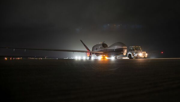 An MQ-4C Triton unmanned aircraft system (UAS) idles on a runway at Andersen Air Force Base after arriving for a deployment as part of an early operational capability (EOC) test to further develop the concept of operations and fleet learning associated with operating a high-altitude, long-endurance system in the maritime domain.  - Sputnik International