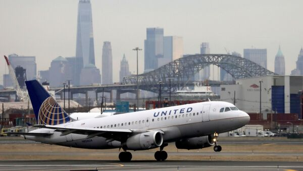A United Airlines passenger jet takes off with New York City as a backdrop, at Newark Liberty International Airport, New Jersey, U.S. December 6, 2019.  - Sputnik International
