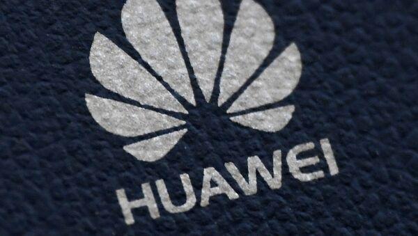 The Huawei logo is seen on a communications device in London, Britain, January 28, 2020 - Sputnik International