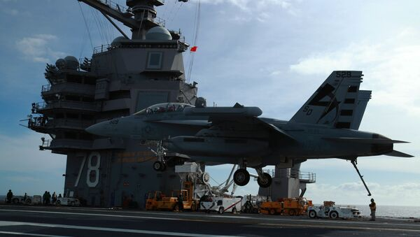 n EA-18G Growler, assigned to Air Test and Evaluation Squadron (VX) 23, prepares to land aboard USS Gerald R. Ford's (CVN 78) flight deck. Ford is currently conducting Aircraft Compatibility Testing to further test its Electromagnetic Aircraft Launch Systems (EMALS) and Advanced Arresting Gear (AAG) - Sputnik International