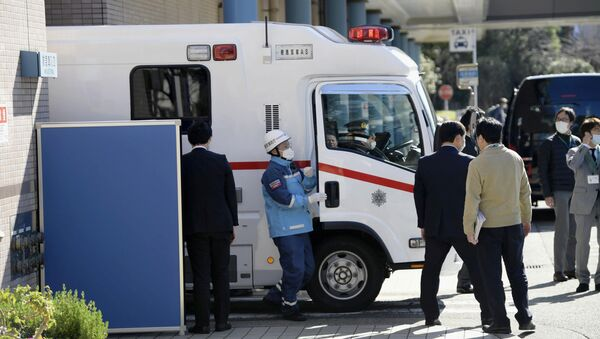 An ambulance carrying a Japanese national who evacuated from Wuhan by a chartered plane, arrives at a hospital in Tokyo, Japan in this photo taken by Kyodo January 30, 2020 - Sputnik International