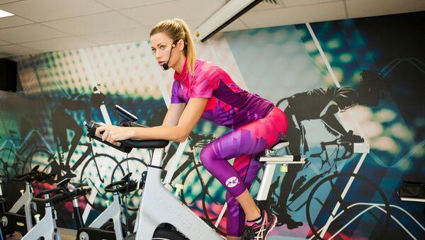 Woman Riding Exercise Bike - Sputnik International