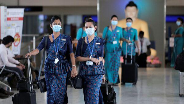 Sri Lankan Airlines staff wear masks at Bandaranaike International Airport after Sri Lanka confirmed the first case of coronavirus in the country, in Katunayake, Sri Lanka January 30, 2020. - Sputnik International