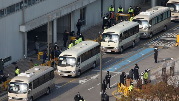 Buses transporting South Koreans evacuees from Wuhan, the epicenter of a virus outbreak in China, leave after arriving at Gimpo International Airport in Gimpo, South Korea, January 31, 2020 - Sputnik International
