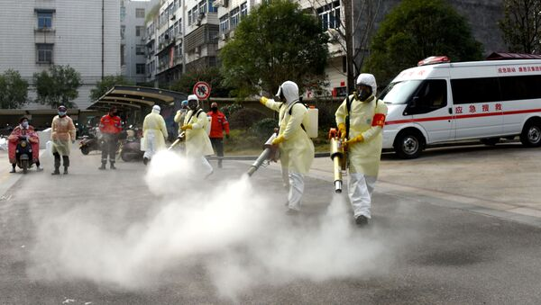Volunteers in protective suits disinfect a residential compound, as the country is hit by the outbreak of a new coronavirus, in Taizhou, Zhejiang province, China January 30, 2020 - Sputnik International