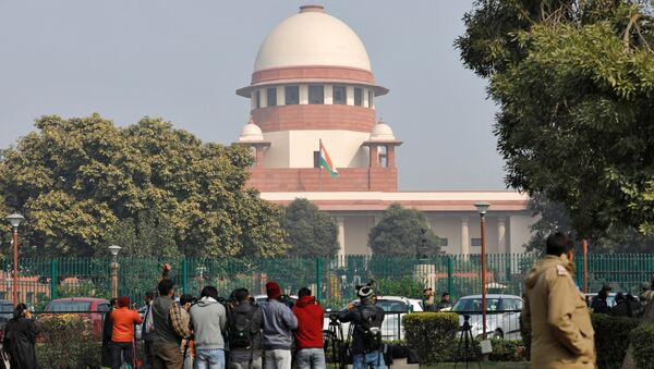 Television journalists are seen outside the premises of the Supreme Court in New Delhi, India, January 22, 2020.  - Sputnik International