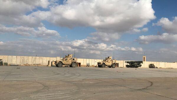 Military vehicles of U.S. soldiers are seen at Ain al-Asad air base in Anbar province, Iraq - Sputnik International