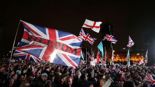 Pro-Brexit demonstrators celebrate on Parliament Square on Brexit day in London, Britain January 31, 2020.  - Sputnik International
