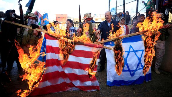 Demonstrators set fire to a makeshift Israeli and U.S. flag during a protest against U.S. President Donald Trump's Middle East peace plan, in Ain al-Hilweh Palestinian refugee camp, near Sidon, Lebanon January 29, 2020 - Sputnik International