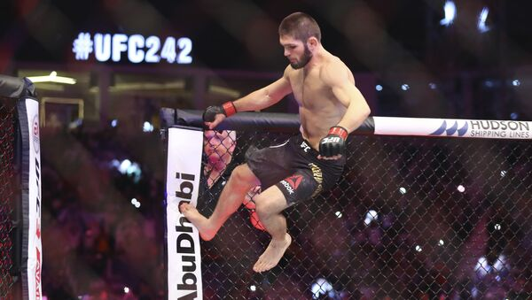 Russian UFC fighter Khabib Nurmagomedov, jumps during Lightweight title mixed martial arts bout at UFC 242, fight against UFC fighter Dustin Poirier, of Lafayette, La., in Yas Mall in Abu Dhabi, United Arab Emirates, Saturday , Sept.7 2019.  - Sputnik International