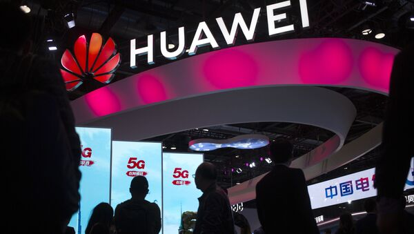 Chinese technology firm Huawei at the PT Expo in Beijing - Sputnik International