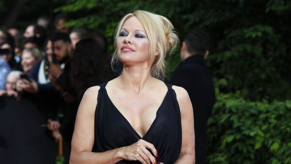 US actress Pamela Anderson arrives with Soccer player Adil Rami at the UNFP (Union of French Professional Footballers) ceremony, in Paris, France, Sunday, May 19, 2019. - Sputnik International
