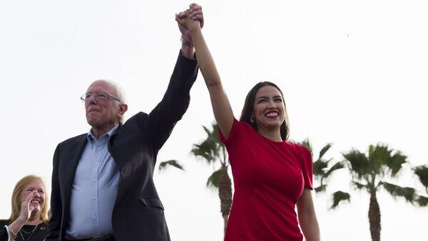 Democratic presidential candidate Sen. Bernie Sanders, I-Vt., and Rep. Alexandria Ocasio-Cortez, D-N.Y. - Sputnik International