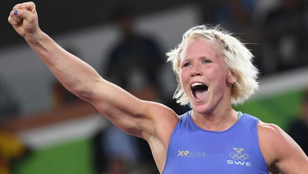 Sweden's Anna Jenny Fransson (blue) celebrates after winning against Canada's Dorothy Erzsebet Yeats in their women's 69kg freestyle bronze medal match on August 17, 2016, during the wrestling event of the Rio 2016 Olympic Games at the Carioca Arena 2 in Rio de Janeiro - Sputnik International