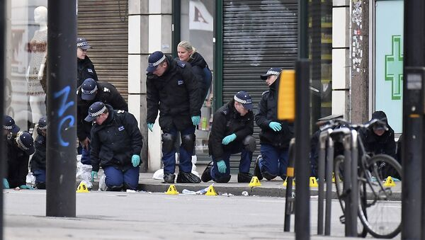 Police officers work at the scene of the 2 February 2020 terror stabbing attack in the Streatham area of south London - Sputnik International