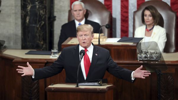 In this Feb. 5, 2019, file photo, President Donald Trump delivers his State of the Union address to a joint session of Congress on Capitol Hill in Washington, as Vice President Mike Pence and Speaker of the House Nancy Pelosi, D-Calif., watch. - Sputnik International