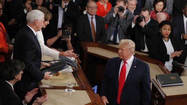 President Donald Trump turns after handing copies of his speech to House Speaker Nancy Pelosi of Calif., and Vice President Mike Pence as he delivers his State of the Union address to a joint session of Congress on Capitol Hill in Washington, Tuesday, Feb. 4, 2020. - Sputnik International