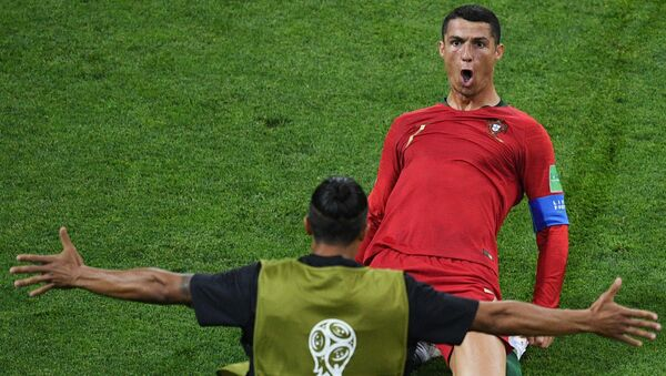 Portugal's Cristiano Ronaldo celebrates a goal during a World Cup Group B soccer match between Portugal and Spain at the Fisht stadium in Sochi, Russia, June 15, 2018. - Sputnik International