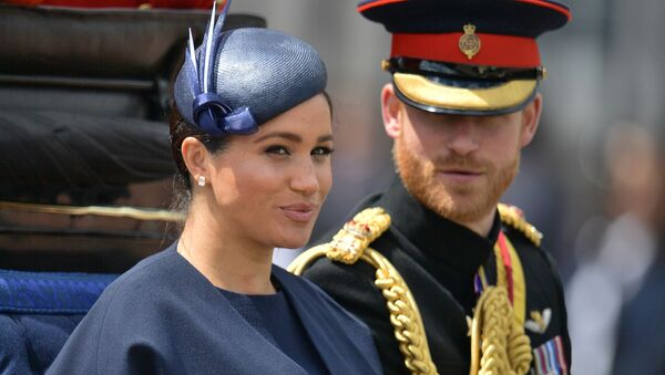 In this file photo taken on June 08, 2019 Britain's Meghan, Duchess of Sussex (L) and Britain's Prince Harry, Duke of Sussex (R) return to Buckingham Palace after the Queen's Birthday Parade, 'Trooping the Colour', in London - Sputnik International