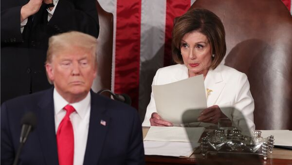 U.S. President Donald Trump speaks near Speaker of the House Nancy Pelosi (D-CA) during his State of the Union address to a joint session of the U.S. Congress in the House Chamber of the U.S. Capitol in Washington, U.S. February 4, 2020 - Sputnik International