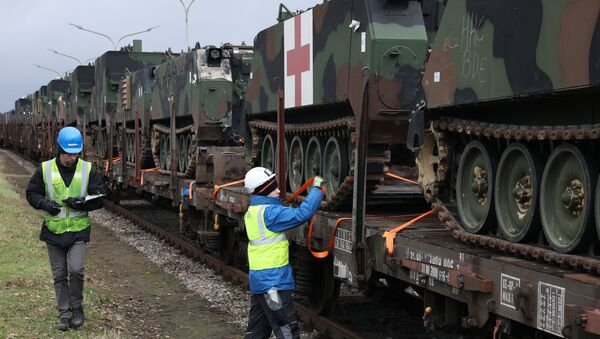 U.S. Army troop carrier vehicles get secured and tagged onto railcars as part of an Army Prepositioned Stock (APS) movement at Coleman Barracks in Mannheim, Germany, Jan. 28, 2019 - Sputnik International