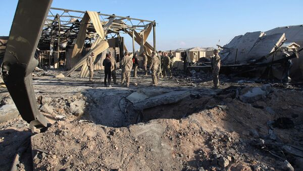 In this Monday, Jan. 13, 2020 photo, U.S. Soldiers stand at spot hit by Iranian bombing at Ain al-Asad air base, in Anbar, Iraq - Sputnik International