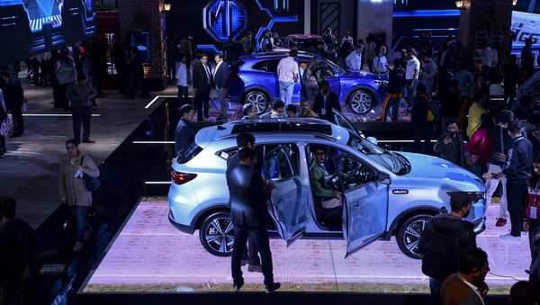 The MG Motor ZS EV pure-electric car is displayed on stage at the Auto Expo 2020 at Greater Noida on the outskirts of New Delhi on February 6, 2020 - Sputnik International