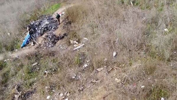 The site of the helicopter crash that killed Kobe Bryant and eight others is seen in a screen grab from drone footage taken in Calabasas, California, U.S. January 27, 2020 and released by the National Transportation Safety Board - Sputnik International