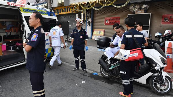 Paramedics and volunteers remain on standby outside the Terminal 21 mall, after a gunman involved in a mass shooting in the mall was confirmed dead, in the Thai northeastern city of Nakhon Ratchasima on February 9, 2020 - Sputnik International
