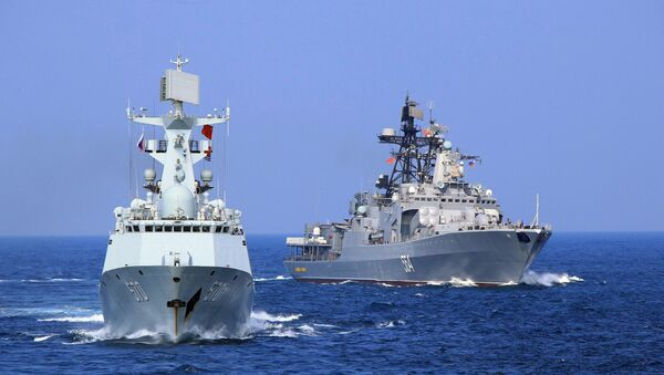 In this Friday, Sept. 16, 2016 photo released by Xinhua News Agency, Chinese Navy frigate Huangshan, left, and Russian Navy antisubmarine ship Admiral Tributs take part in a joint naval drill at sea off south China's Guangdong Province.  - Sputnik International