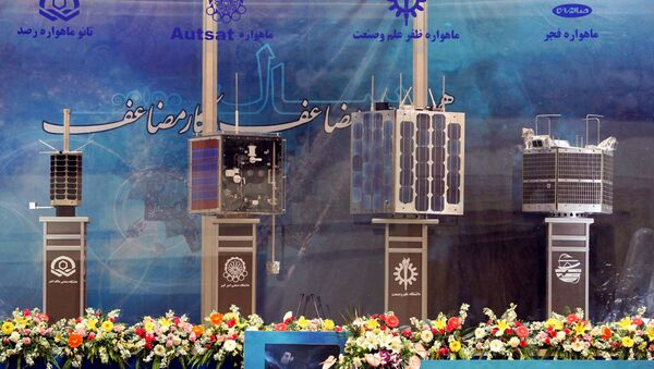 Iran's prototypes of four new satellites (from L) Rasad, Amir Kabir-1, Zafar and Fajr, are on display during their unveiling ceremony in Tehran on 7 February 2011  - Sputnik International