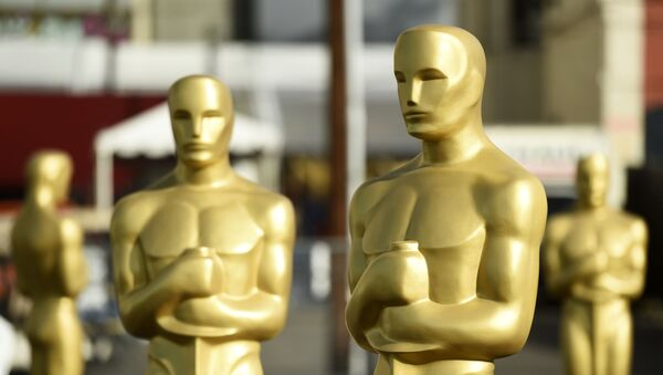 Oscar statues stand off of Hollywood Boulevard in preparation for Sunday's 92nd Academy Awards at the Dolby Theatre, Wednesday, Feb. 5, 2020, in Los Angeles - Sputnik International
