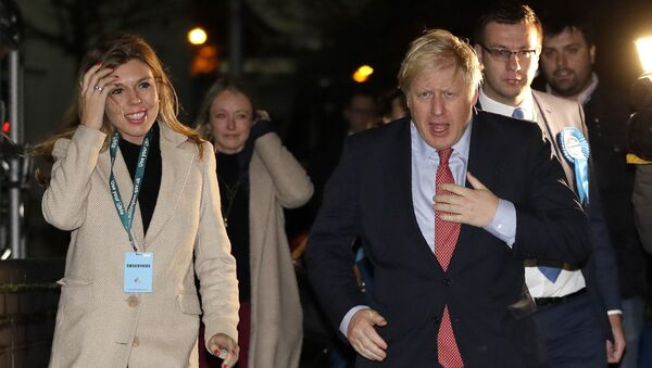Britain's Prime Minister and Conservative Party leader Boris Johnson and his partner Carrie Symonds arrives for the Uxbridge and South Ruislip - Sputnik International