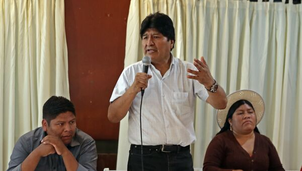 Bolivian ex-president Evo Morales (C), exiled in Argentina, speaks flanked by members of his Movimiento al Socialismo - Movement for Socialism - (MAS) party - Sputnik International