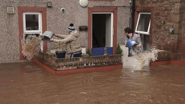 Men try to control the flow of flood water, outside a property, in Appleby-in-Westmorland, as Storm Ciara hits the UK, in Cumbria, England, Sunday Feb. 9, 2020 - Sputnik International