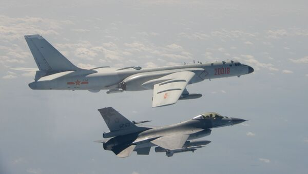 An H-6 bomber of Chinese PLA Air Force flies near a Taiwan F-16 in this February 10, 2020 handout photo provided by Taiwan Ministry of National Defense. - Sputnik International
