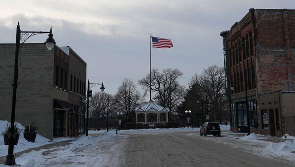 An American flag waves from a pole down a street in Fort Dodge, Iowa - Sputnik International