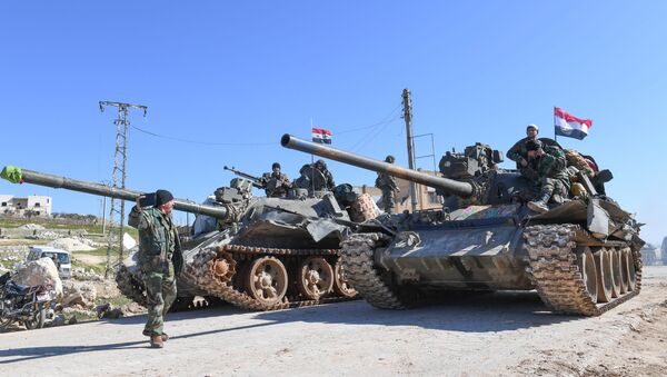 Syrian army units advance in the town of al-Eis in south Aleppo province on February 9, 2020, following battles with rebels and jihadists - Sputnik International