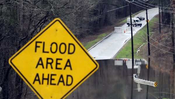 Vehicles turn around on a road blocked by floodwaters in Helena, Ala., on Tuesday, Feb. 11, 2020. The National Weather Service said flooding was expected from central Mississippi to north Georgia following downpours, and severe storms could follow the rain.  - Sputnik International