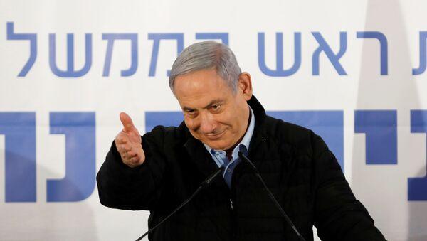 Israeli Prime Minister Benjamin Netanyahu gestures as he speaks during an event marking Tu BiShvat, the Jewish Arbor Day, in the Israeli settlement of Mevo'ot Yericho, in the Israeli-occupied West Bank February 10, 2020 - Sputnik International