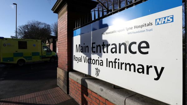 An ambulance stands near the entrance to Royal Victoria Infirmary, where two confirmed coronavirus patients are being treated, in Newcastle, Britain February 1, 2020 - Sputnik International