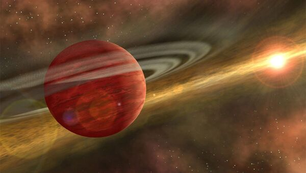 Artist's conception of a massive planet orbiting a cool, young star. In the case of the system discovered by RIT astronomers, the planet is 10 times more massive than Jupiter, and the orbit of the planet around its host star is nearly 600 times that of Earth around the sun. - Sputnik International
