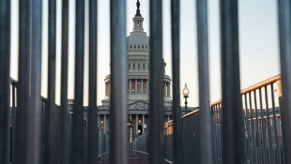 The U.S. Capitol building exterior is seen at sunset as members of the Senate participate in the first day of the impeachment trial of President Donald Trump in Washington, U.S., January 21, 2020. - Sputnik International